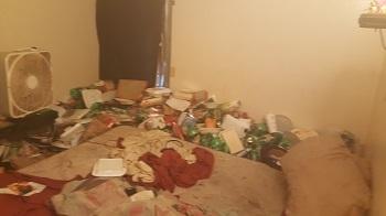 apt bedroom needing decluttered